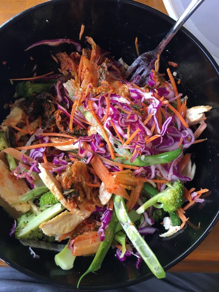 A mixture of Red cabbage, green beans, broccoli, carrot and kimchi